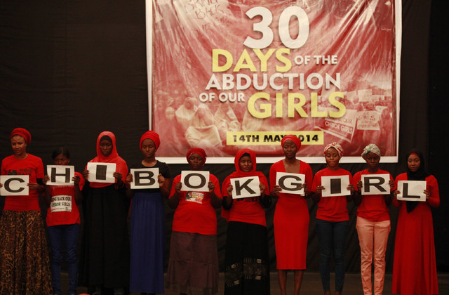 In Wednesday, May 14, 2014 file photo, people attend a vigil to mark one month since the girls of a government secondary school in Chibok were kidnapped, in Abuja, Nigeria. Islamic extremists have ...