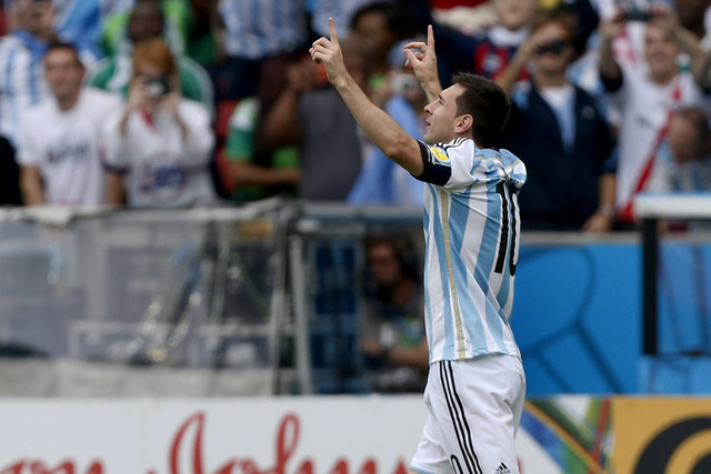 Argentina's Lionel Messi celebrates after scoring his side's first goal during the group F World Cup soccer match against Nigeria at the Estadio Beira-Rio in Porto Alegre, Brazil, Wednesday, June  ...