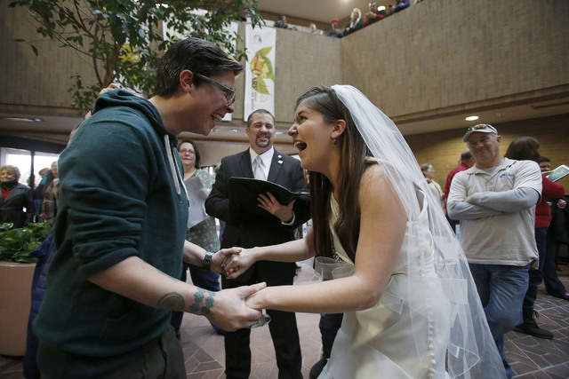 In this Dec. 23, 2013, file photo, Jax and Heather Collins get married at the Salt Lake County clerk's office, in Salt Lake City. (AP Photo/Deseret News, Ravell Call, File)