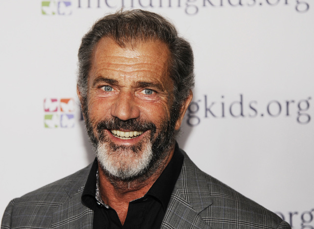 "Mel Gibson poses at the Mending Kids ""Rock N' Roll All Star Event"" in West Hollywood, Calif. Actor Gary Oldman is defending fellow actors Mel Gibson and Alec Baldwin from critics of their comments ..."