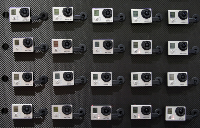 A display of GoPro's HERO3 video cameras is shownat the International Consumer Electronics Show in Las Vegas on Jan. 8, 2013. GoPro, the maker of wearable sports cameras, is expected to start sell ...