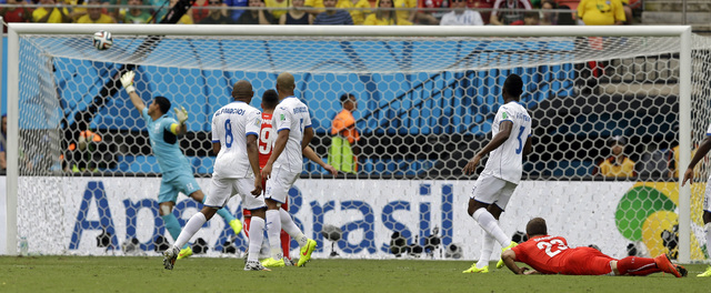 A shot from Switzerland's Xherdan Shaqiri, right, goes into the net for the opening goal during the group E World Cup soccer match between Honduras and Switzerland at the Arena da Amazonia in Mana ...
