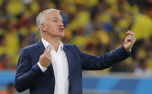France's head coach Didier Deschamps directs his players during the group E World Cup soccer match between Ecuador and France at the Maracana stadium in Rio de Janeiro, Brazil, Wednesday, June 25, ...