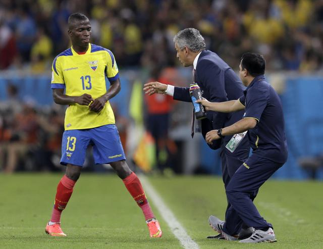 Ecuador's head coach Reinaldo Rueda gives directions to Ecuador's Enner Valencia during the group E World Cup soccer match between Ecuador and France at the Maracana Stadium in Rio de Janeiro, Bra ...
