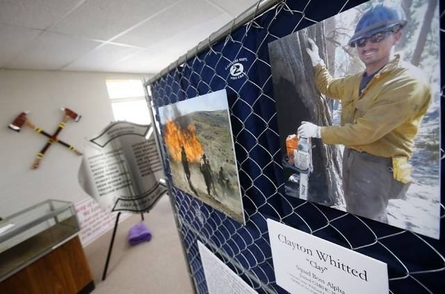 Artifacts and photographs honor the 19 Granite Mountain Hotshots killed nearly a year ago fighting a wildfire as part of a memorial exhibit being to mark the year anniversary of their deaths on Tu ...