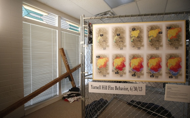 Displays near completion to mark the upcoming one year anniversary of the deaths of 19 Granite Mountain Hotshots for the Tribute Fence Preservation Project on Tuesday, June 24, 2014, in Prescott,  ...