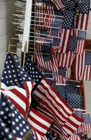 Hundreds of flags have been saved from a makeshift memorial now part of the Tribute Fence Preservation Project honoring the 19 Granite Mountain Hotshots who were killed nearly a year ago fighting  ...