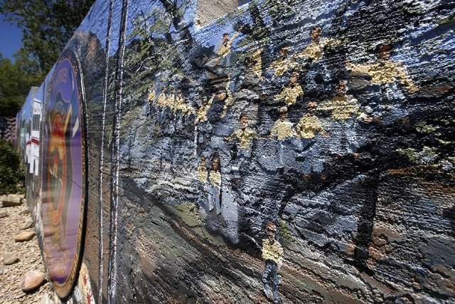 A painted mural by Juliana Hutchins covers a retaining wall  memorial honoring the 19 Granite Mountain Hotshots who died nearly a year ago fighting an Arizona wildfire on Tuesday, June 24, 2014, i ...