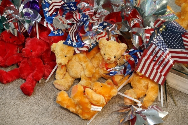 Just some of the dozens of teddy bears saved for the Tribute Fence Preservation Project honoring the 19 Granite Mountain Hotshots who were killed nearly a year ago fighting an Arizona wildfire on  ...