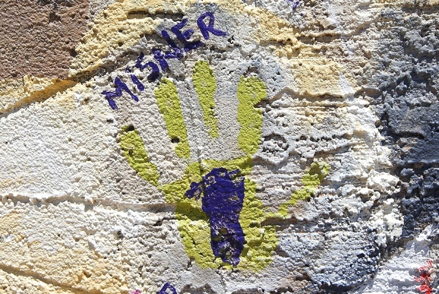 The handprint of Amanda Misner, wife of Sean Misner who perished as one of the 19 Granite Mountain Hotshots fighting an Arizona wildfire, dwarfs the footprint of the son he never knew, as the pain ...