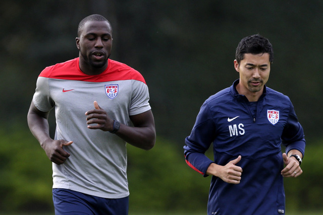 United States' Jozy Altidore, left, works out with trainer Masa Sakihana during a training session in Sao Paulo, Brazil, Saturday, June 28, 2014. The U.S. will play against Belgium in the round 16 ...