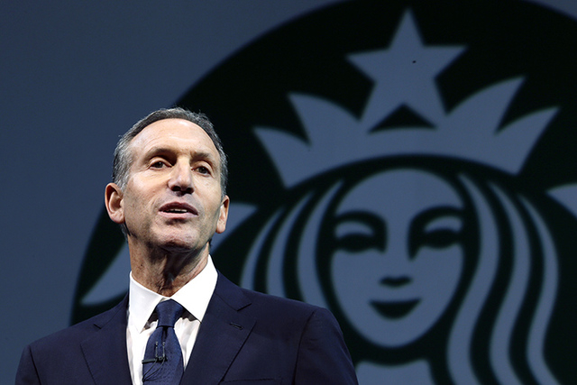 In this March 20, 2013 file photo, Starbucks CEO Howard Schultz speaks at the company's annual shareholders meeting, in Seattle, Wash. Schultz is collaborating on a book about veterans of the wars ...
