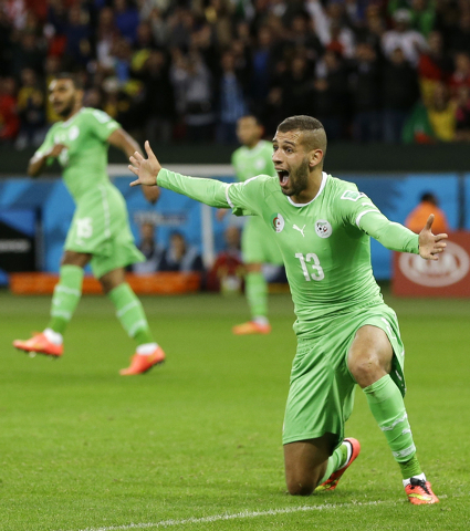 Algeria's Islam Slimani pleads to the referee for a call on a play during the World Cup round of 16 soccer match between Germany and Algeria at the Estadio Beira-Rio in Porto Alegre, Brazil, Monda ...