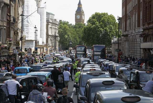 Taxi drivers block the road in Whitehall in central London on Wednesday, June 11, 2014. Taxi drivers created traffic chaos in Europe's top cities on Wednesday by mounting one of the biggest ever p ...