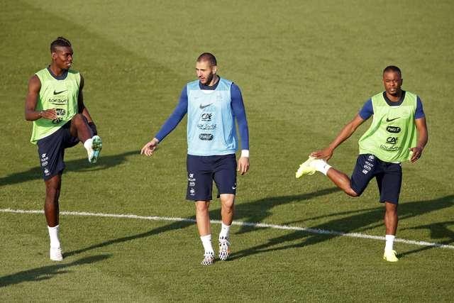 France's national soccer team players Paul Pogba (L),  Karim Benzema (C), and Patrice Evra (R),  attend a training session at the Botafogo soccer club's Santa Cruz stadium in Ribeirao Preto, 336 k ...