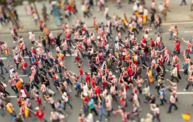 Football supporters going to Camp Nou stadium. (ThinkStock)