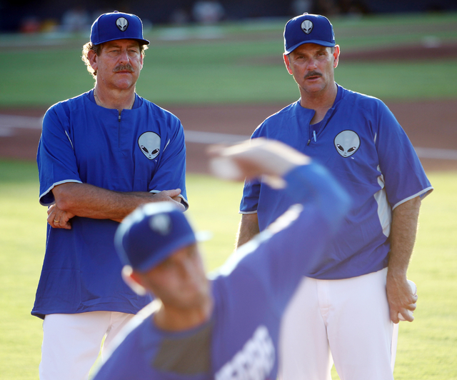 51s pitching coach Frank Viola, left, and Ron Romanick, pitching coordinator for the Met's minor league system, watch starting pitcher Darin Gorski warm up before a baseball game against the Fresn ...
