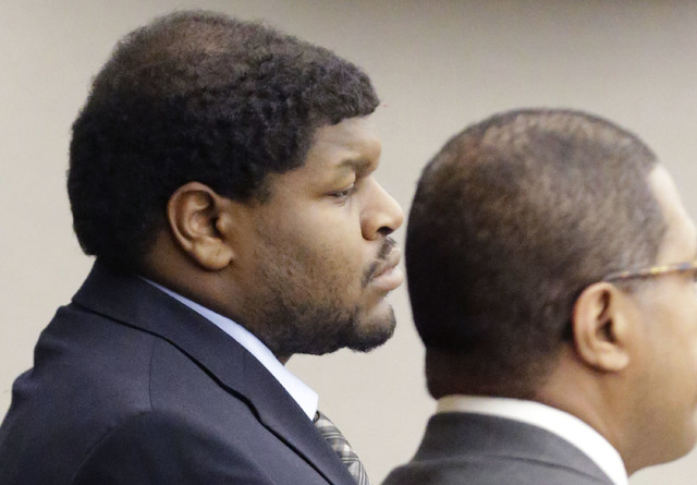 Josh Brent, left, former Dallas Cowboys NFL football player, listens with one of his lawyers Kevin Brooks while the punishment for his intoxication manslaughter conviction is read in court  Friday ...