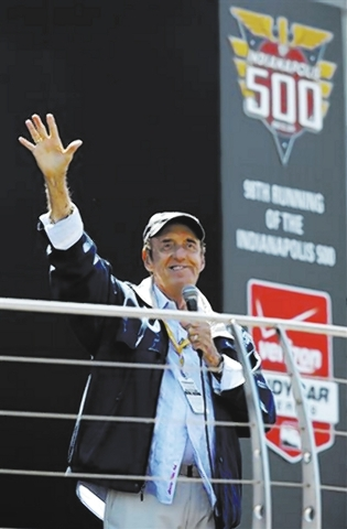 """Jim Nabors waves to fans after singing """"(Back Home Again in) Indiana"""" for the final time before the start of the 98th running of the Indianapolis 500 IndyCar auto race at the Indianapoli ..."""