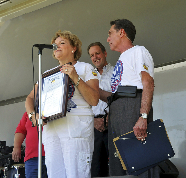 Laura Coleman and Richard Cherchio accept an Appreciation Certificate from Mayor John Lee during the inaugural Nellis, Creech and Military Veterans Appreciation Day at Craig Ranch Park in North La ...