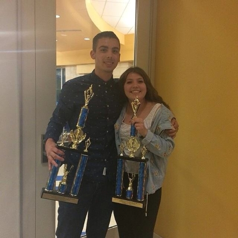 Adelson Educational Campus senior Dominic Bembenek, left, and junior Mackenzie Lally display their 2013-14 Student-Athlete of the Year Award trophies after being recognized for their excellence in ...