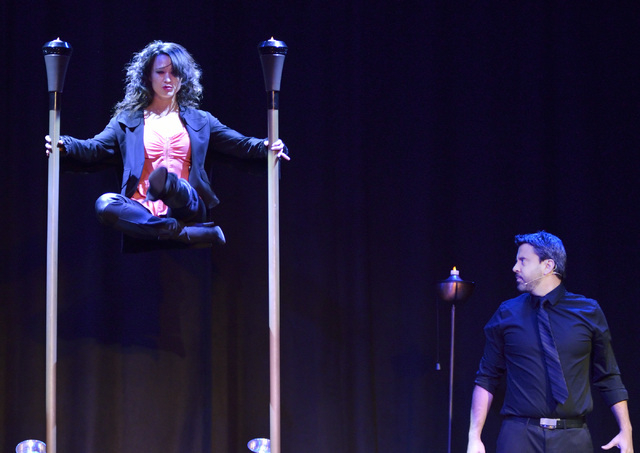 """Magician Reynold Alexander, right, appears to make assistant Deena Cary float during """"Magia"""" in the Wolf Theater at The Clarion. (Bill Hughes/Las Vegas Review-Journal)"""