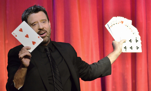 """Magician Reynold Alexander performs during """"Magia"""" in the Wolf Theater at the Clarion hotel-casino at 305 Convention Center Drive in Las Vegas on Thursday, May 29, 2014. (Bill Hughes/Las ..."""