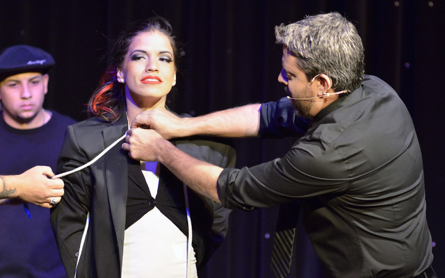"""Magician Reynold Alexander, right, prepares to make assistant Jessica Delgado disappear during """"Magia"""" in the Wolf Theater at the Clarion hotel-casino at 305 Convention Center Drive in L ..."""