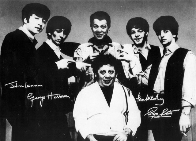 Steve Rossi and Marty Allen, the comic duo Allen & Rossi, pose with the Beatles in Las Vegas. (Courtesy)