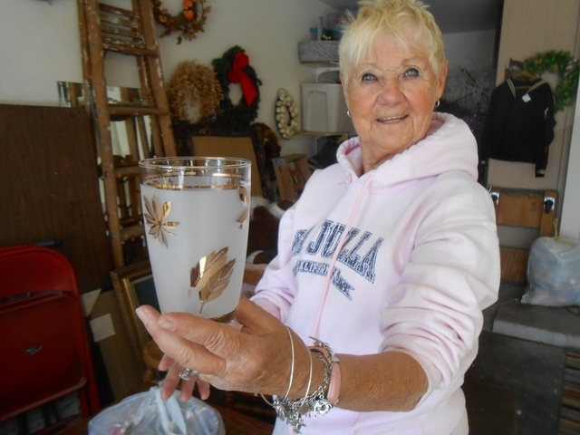 "Summerlin resident Andi Goldstein shows off glassware popular in the 1940s and 1950s May 12 in her garage. A longtime antiques dealer, she's joined Michael Mack's KDWN radio show ""Pawn Talk Live,"" ..."