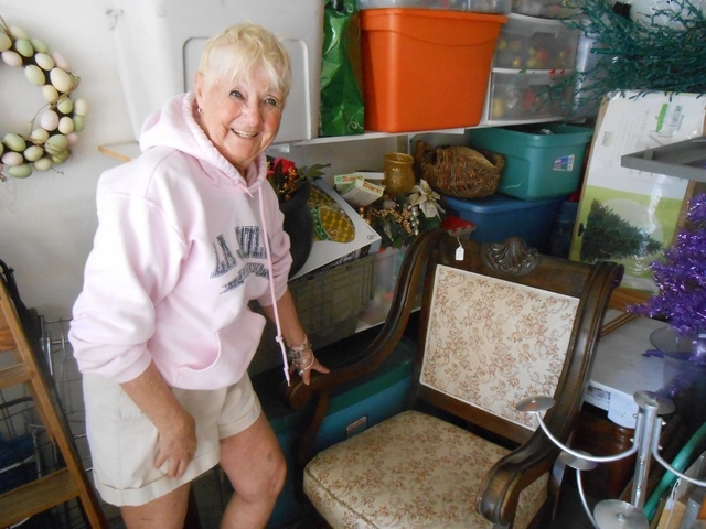 A birthing chair from the 1800s and notable for its low seat, which better positioned a midwife, sits in Andy Goldstein's garage, May 12. It is a rare find and one that the antique dealermay take  ...