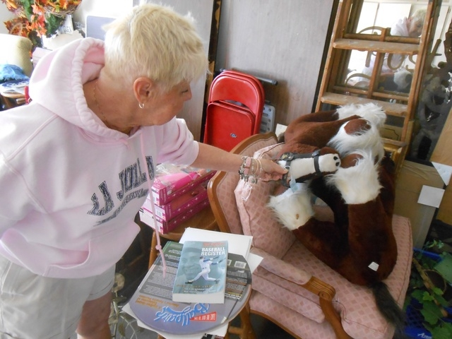 Andi Goldstein points out stuffed Budweiser horses in her Summerlin garage. Besides antiques, she also deals in collectibles. (Jan Hogan/View)