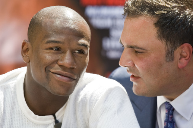 Richard Schaefer, right, shown with Floyd Mayweather Jr. Schaefer announced his resignantion form Goldon Boy Promotions on Monday. (AP File Photo/Mark Avery)