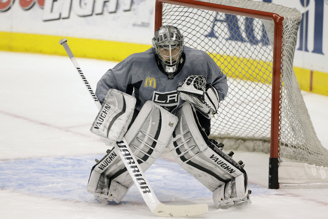 Los Angeles Kings goalie Jonathan Quick stands in front of his goal during practice for Wednesday's Game 1 of the NHL Stanley Cup Final hockey series against the New York Rangers on Tuesday, June  ...