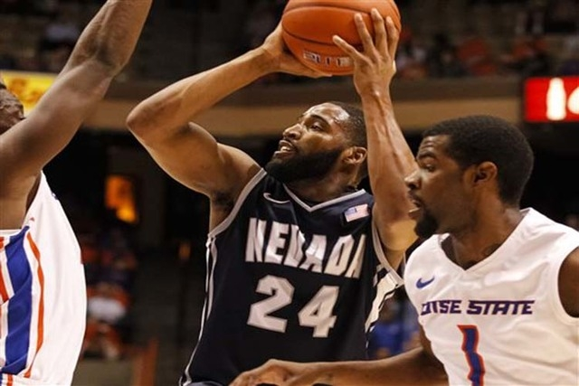 Nevada's Deonte Burton (24) shoots during the first half of an NCAA college basketball game against Boise State in Boise, Idaho, on Wednesday, March 5, 2014. (AP Photo/Otto Kitsinger)
