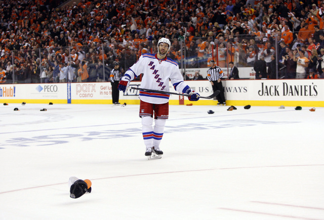 New York Rangers' Dominic Moore skates around the ice during the second period in Game 6 of an NHL playoff series in Philadelphia. Moore is nominated for the Bill Masterton Memorial Trophy, which  ...