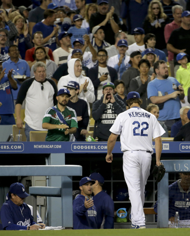 Los Angeles Dodgers starting pitcher Clayton Kershaw walks to the dugout after the end of the top of the seventh inning of a baseball game against the Colorado Rockies in Los Angeles, Wednesday, J ...