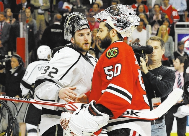 Los Angeles Kings goalie Jonathan Quick (32) greets Chicago Blackhawks goalie Corey Crawford after the Kings defeated the Blackhawks 5-4 in overtime in Game 7 of the Western Conference finals Sund ...