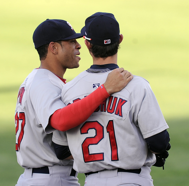 Memphis Redbirds outfielder Tommy Pham jokes around with center fielder Randal Grichuk before the start of a Triple-A minor league baseball game against the Las Vegas 51s at Cashman field in Las V ...