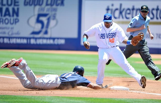 Las Vegas 51 first baseman Brandon Allen (40) looks to pick off Reno's Alfredo Marte during their minor league baseball game at Cashman Field on Sunday, June 1, 2014. (David Becker/Las Vegas Revie ...