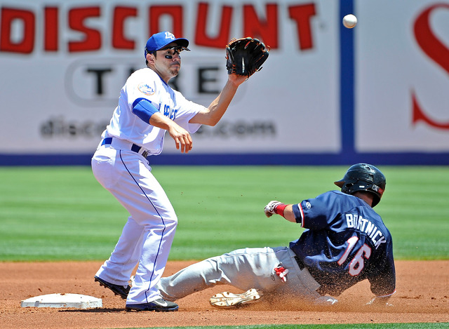 Las Vegas 51 shortstop Omar Quintanilla looks for the pick off as Reno's Tyler Bortnick (16) slides into second base during their minor league baseball game at Cashman Field on Sunday, June 1, 201 ...