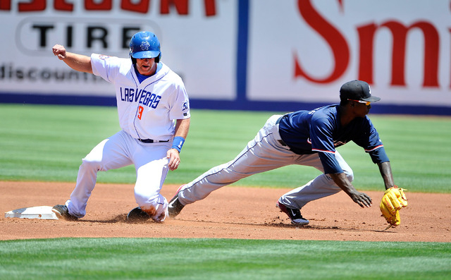 Las Vegas 51's Omar Quintanilla (3) slides safely into second base with Reno's Didi Gregorius covering during their minor league baseball game at Cashman Field on Sunday, June 1, 2014. (David Beck ...
