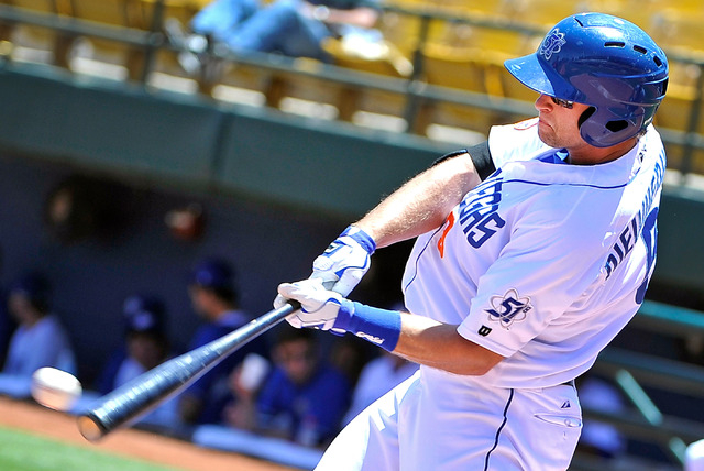 Las Vegas 51's Kirk Nieuwenhuis connects with the ball against Reno during a minor league baseball game at Cashman Field on Sunday, June 1, 2014. (David Becker/Las Vegas Review-Journal)