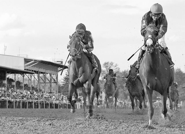 ADVANCE FOR WEEKEND EDITIONS, JUNE 1-2 - In this May 17, 2014 file photo, California Chrome, right, Victor Espinoza up, wins the 139th Preakness Stakes horse race  ahead Ride on Curlin, left,  who ...