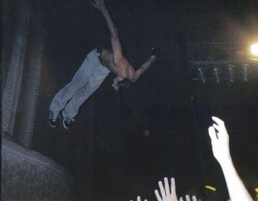 311 singer-guitarist Nick Hexum balcony-jumps in Peoria in 2002. (Courtesy)