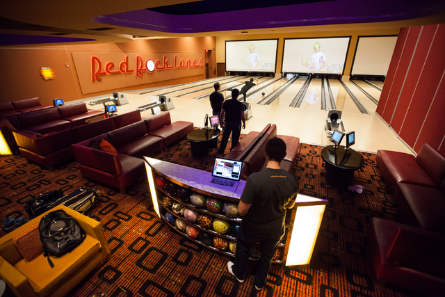 Rolltech founder and CEO Rich Belsky, top, rolls a bowling ball at Red Rock Lanes in Red Rock Resort in Las Vegas on May 29. (Chase Stevens/Las Vegas Review-Journal)