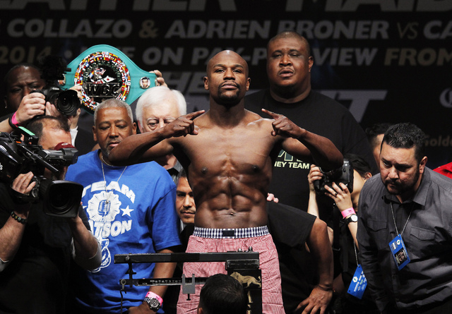 Boxer Floyd Mayweather Jr. poses during the official weigh-in prior to his fight against Marcos Maidana at the MGM Grand Garden Arena in Las Vegas on Friday, May 2. (Jason Bean/Las Vegas Review-Jo ...
