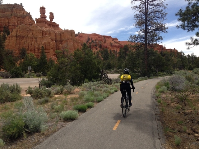 Nancy, a bicyclist tourist from Sacramento, Calif., bikes on a paved trail through Red Canyon on the way to Bryce Canyon National Park. (ALAN SNEL/LAS VEGAS REVIEW-JOURNAL)