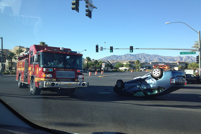 First responders are on the scene of a single-vehicle rollover crash that is affecting traffic in the northwest valley. (Jason Bean, Las Vegas Review-Journal)