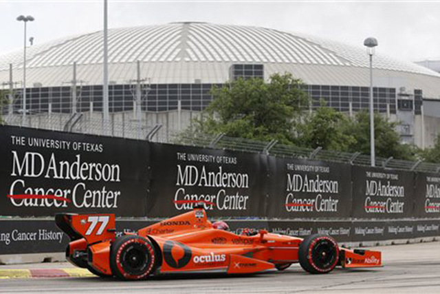 Simon Pagenaud, of France, comes out of Turn 3 near the Astrodome during the second IndyCar Grand Prix of Houston auto race Sunday, June 29, 2014, in Houston. (AP Photo/David J. Phillip)